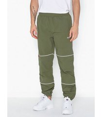 fila men upendo wind pants byxor green