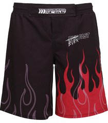 vision of super black pants with red flame