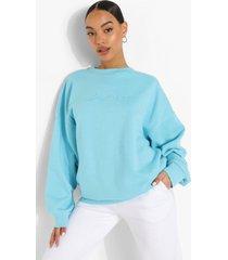 oversized geborduurde woman sweater met tekst, turquoise