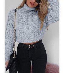 suéter de punto de ochos de manga larga con cuello alto