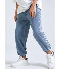 cintura elástica con dobladillo con cordón y estampado de letras laterales para hombre jeans