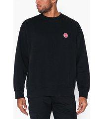 nudie jeans lukas logo tröjor svart