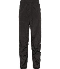 stone island logo patch rip-stop track trousers - black