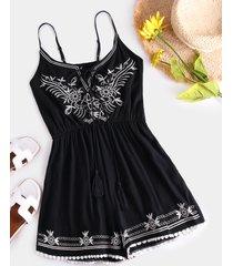 mono corto sin mangas con estampado floral y diseño sin espalda negro