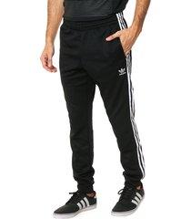 pantalón negro adidas originals sst