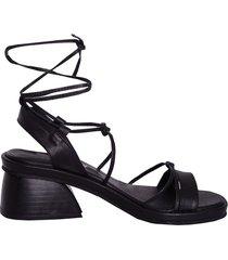 zapato negro lucerna