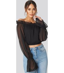 hanna weig x na-kd off shoulder frill neck blouse - black