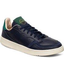 supercourt låga sneakers blå adidas originals