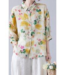 camicetta ampia con maniche a 3/4 e risvolto con stampa di foglie floreali