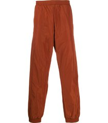 a-cold-wall* overlock nylon track pants - orange