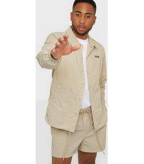 fila malone woven coach jacket jackor tan