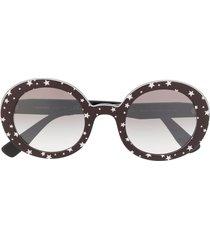 miu miu eyewear circle frame star print sunglasses - black