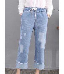 jeans a vita geometrica delle coulisse della stampa delle stelle d'annata per le donne