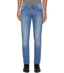 slim fit mid wash jeans