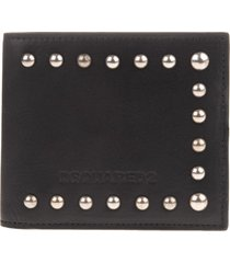 man folding wallet in black leather with studs