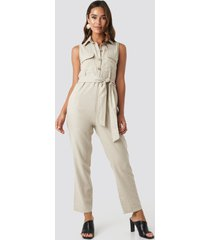 trendyol belted front button detailed jumpsuit - beige
