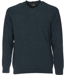 green pullover with multicolor label