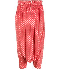 comme des garçons pre-owned 2000s polka dot harem trousers - red