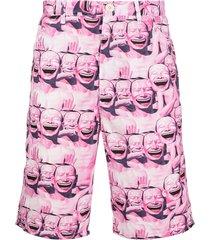 comme des garçons shirt face-print bermuda shorts - pink