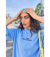 pride isn't just a party oversized t-shirt