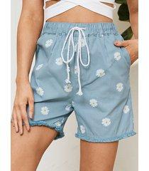 pantalones cortos de mezclilla con bolsillos laterales con estampado floral azul