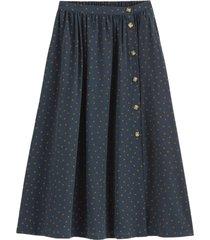 halvlång, utställd kjol med prickmönster