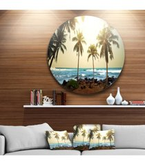 "designart 'rocky tropical beach with palms' seashore oversized metal circle wall art - 23"" x 23"""