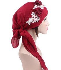 turbante in cotone con fiori decorativi