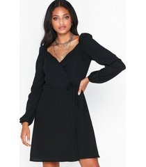 glamorous long sleeve crossover dress festklänningar