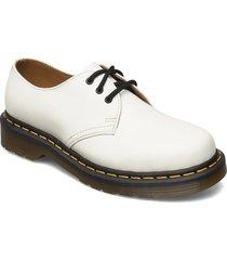 1461 snörade skor låga vit dr. martens