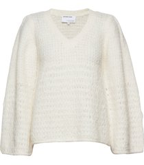 caress v-neck sweater stickad tröja vit designers, remix