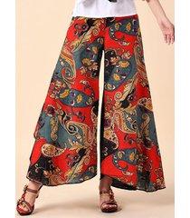 donna pantaloni a zampa di elefante con stampa folcloristica di patchwork
