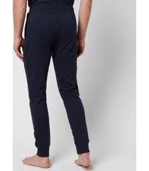 emporio armani men's all over logo terry trousers - blue - xl