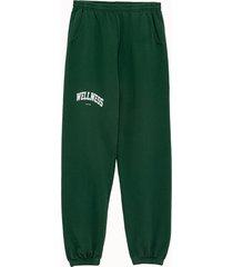 sporty & rich pantalone in felpa stampa wellness ivy