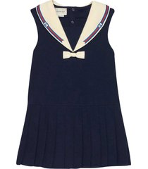 gucci blue dress with bow and multicolor details