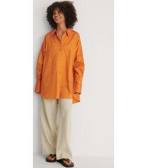 na-kd trend recycled oversize skjorta med ficka - orange