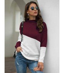 suéter de manga larga con cuello alto y bloque de color