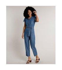 macacão jeans feminino com bolsos e faixa para amarrar manga curta azul médio
