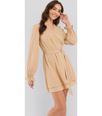 na-kd boho overlap draped mini dress - beige