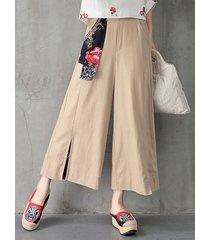 la piega floreale di stile popolare ha condiviso i pantaloni delle donne di alta vita