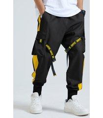 bolsillo de cintura elástica con cinta de bloque de color informal para hombre carga pantalones
