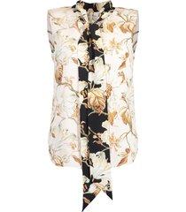 ivory sleeveless neck tie printed blouse