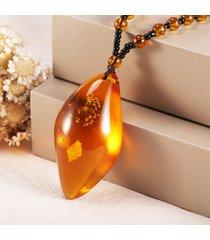 collana etnica con perline a forma di goccia