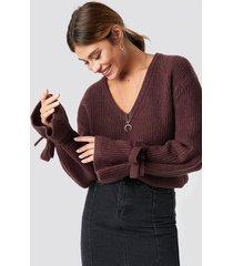 linn ahlborg x na-kd v-neck tie sleeve sweater - red