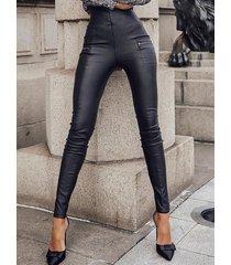 bolsillos negros con cremallera de cintura alta pantalones