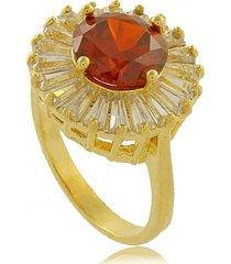 anel redondo com pedra vermelha e explosões em zircônias 3rs semijoias dourado