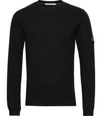 monogram badge waffle ls tee stickad tröja m. rund krage svart calvin klein jeans
