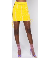 akira luna skirt with lace up and contrast fabric trim