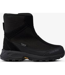 boots vibram® arctic grip med bra grepp på hal, våt is.