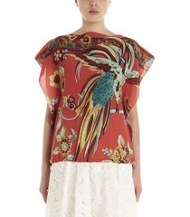 red valentino bird of parad in forest top